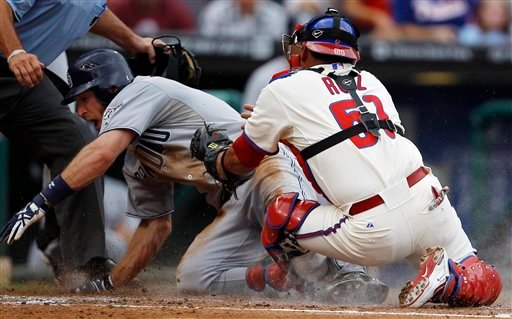 San Diego Padres' Chris Denorfia, left, steals home against Philadelphia Phillies catcher Carlos Ruiz in the second inning of a baseball game, Monday, July 25, 2011, in Philadelphia.