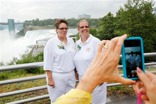 Sharon Gerbracht, left, and Nancy Gerbracht, right, pose for a photo before being married in a group same-sex marriage in Niagara Falls, N.Y., Monday, July 25, 2011.