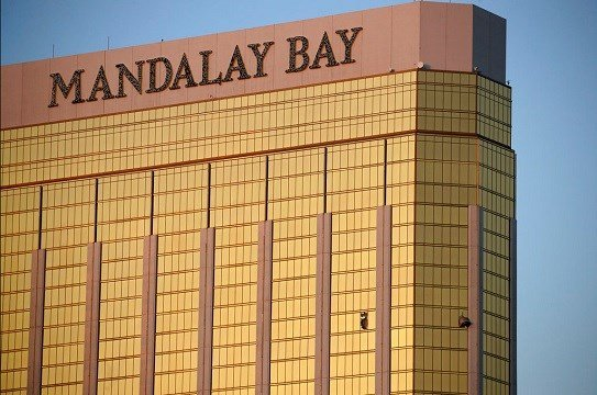 Drapes billow out of broken windows at the Mandalay Bay resort and casino on the Las Vegas Strip.