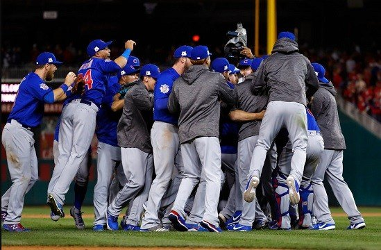 The Chicago Cubs celebrate after beating the Washington Nationals 9-8.