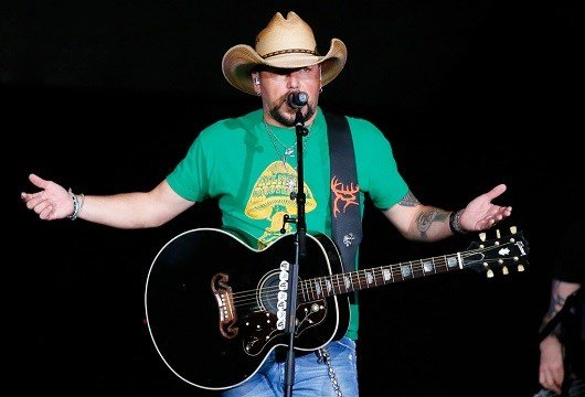 Jason Aldean addresses the crowd about the shooting in Las Vegas during his concert in Tulsa, Okla.