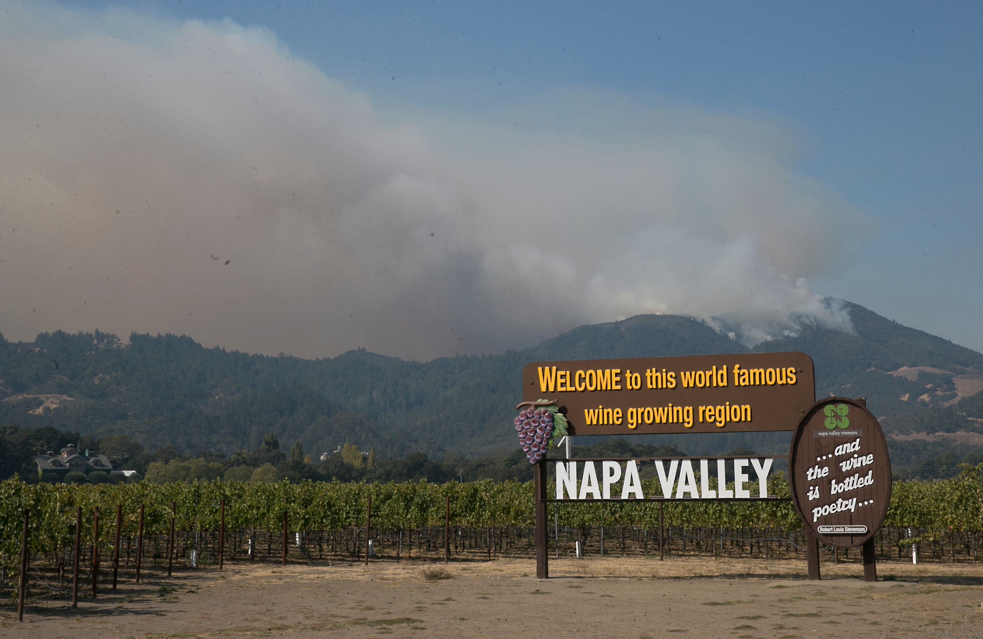 Firefighters gained some ground on a blaze burning in the heart of California's wine country but face another tough day ahead with low humidity and high winds expected to return. (AP Photo/Rich Pedroncelli)
