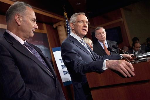 Senate Majority Leader Sen. Harry Reid of Nev., second from left, speaks during a news conference on debt ceiling legislation July 27, 2011, on Capitol Hill in Washington. (AP Photo/Evan Vucci)