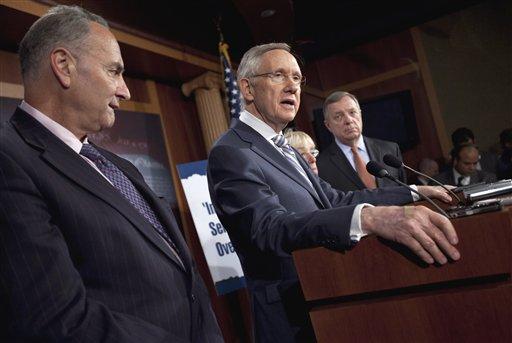 Senate Majority Leader Sen. Harry Reid of Nev., second from left, speaks during a news conference on debt ceiling legislation July 27, 2011, on Capitol Hill in Washington. (AP Photo/Evan Vucci)