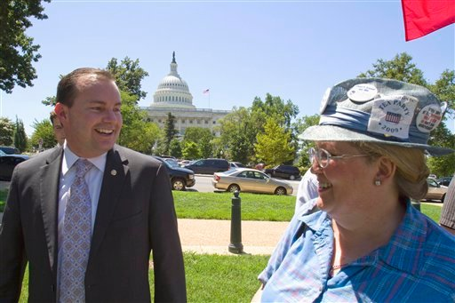 Sen. Mike Lee, R-Utah, greets a supporter at a Tea Party rally on Capitol Hill in Washington, Wednesday, July 27, 2011.