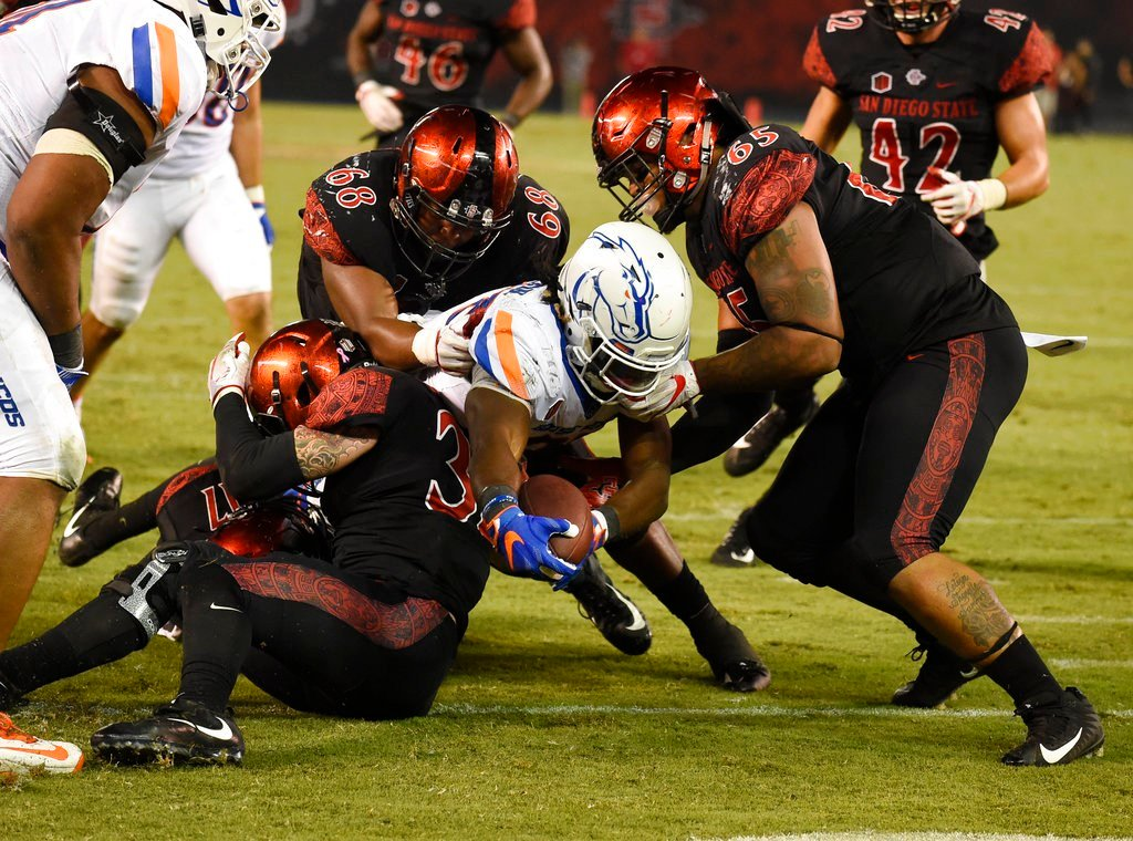 Boise State running back Alexander Mattison (22) scores a touchdown past San Diego State defenders during the second half of an NCAA college football game Saturday, Oct. 14, 2017, in San Diego. (AP Photo/Denis Poroy)