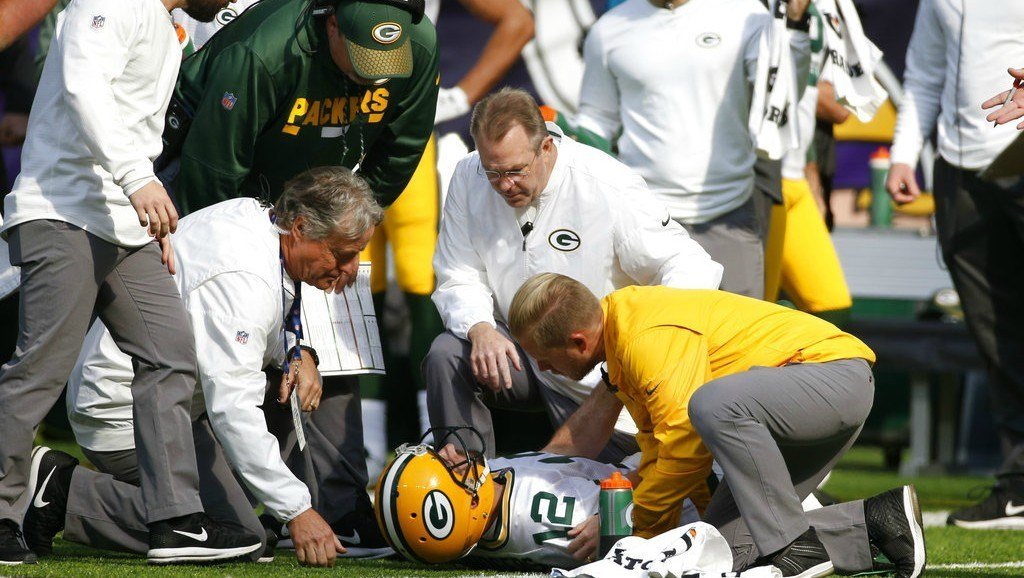 Green Bay Packers quarterback Aaron Rodgers is attended to by medical staff after being hit by Minnesota Vikings outside linebacker Anthony Barr in the first half of an NFL football game in Minneapolis on Sunday. (AP Photo/Bruce Kluckhohn)