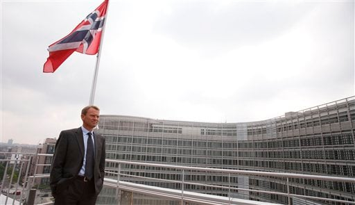 Director of the Norwegian Police Security Service, Jon Fitje, looks out at EU headquarters from the roof of the Norway House in Brussels on July 28, 2011. (AP Photo/Virginia Mayo)