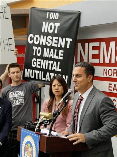 State Assemblyman Mike Gatto, right, of Los Angeles speaks about circumcision outside a medical clinic as state Assemblywoman Fiona Ma, center, and a protester look on during a news conference in San Francisco, Thursday, July 21, 2011.