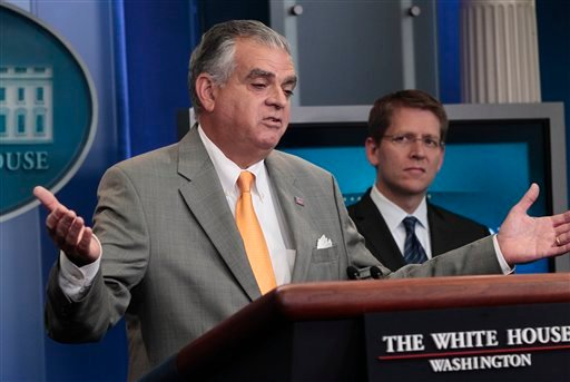 White House Press Secretary Jay Carney looks on at right, as Transportation Secretary Ray LaHood, speaks during daily news briefing at the White House in Washington, Thursday, July, 28, 2011.