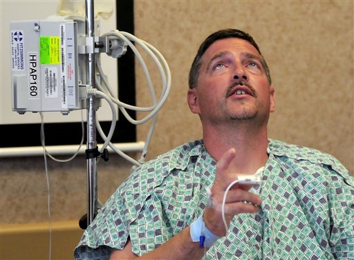 Michael W. Trapp, 42, describes his ordeal during a news conference at Covenant HealthCare Cooper Campus in Saginaw, Mich. on Thursday, July 28, 2011.