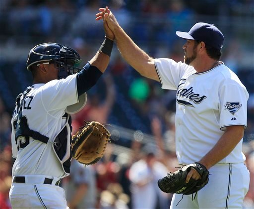 San Diego Padres closer Heath Bell, right, and catcher Luis Martinez celebrate after Bell earned his 30th save in the Padres' 4-3 victory over the Arizona Diamondbacks in a baseball game on Thursday, July 28, 2011, in San Diego.
