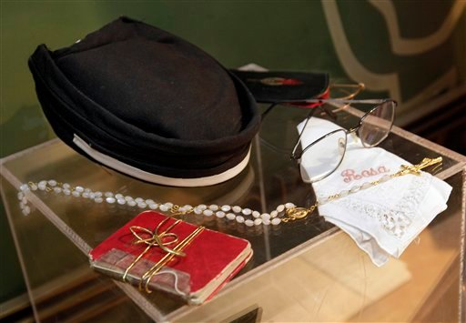 July 25, 2011 photo: an address book, a rosary, eyeglasses, a handkerchief and a stewardess' hat from the St. Matthew AME Church, all belonging to Rosa Parks, are shown in this photo at Guernsey's auction house, in New York. (AP Photo/Richard Drew)