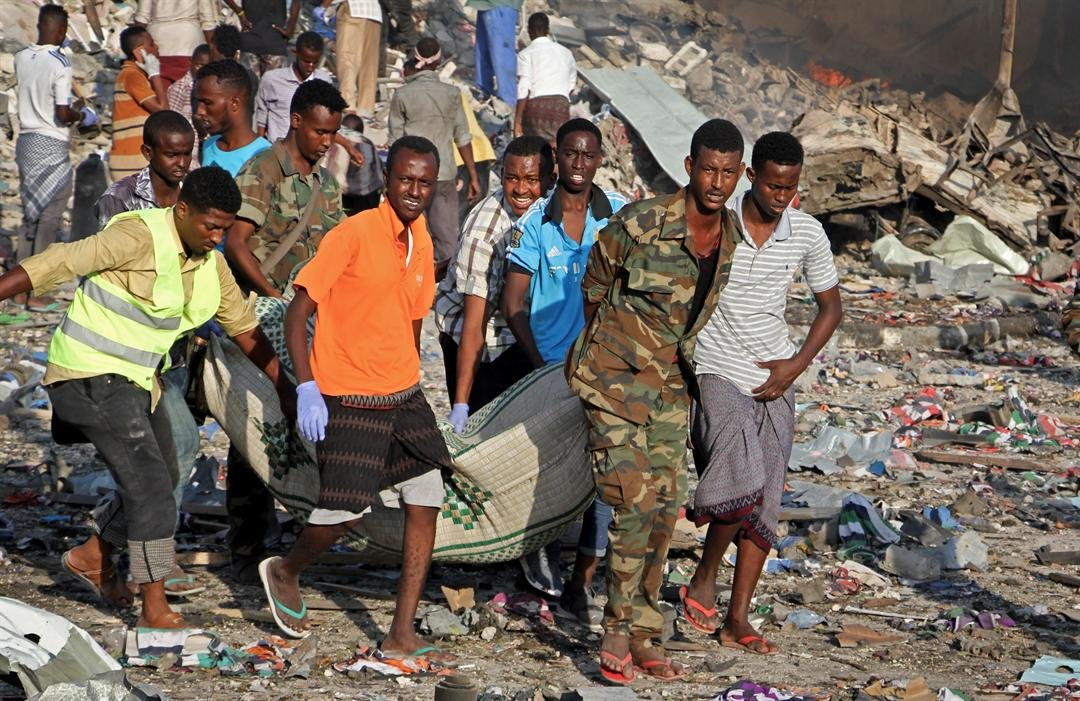 A huge explosion from a truck bomb has killed at least 20 people in Somalia's capital, police said Saturday, as shaken residents called it the most powerful blast they'd heard in years. (AP Photo/Farah Abdi Warsameh)