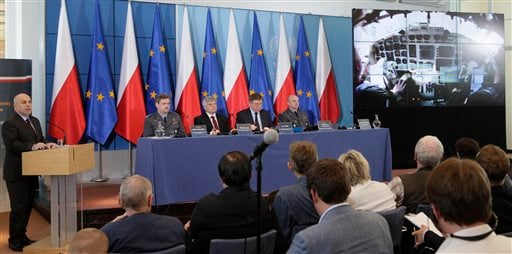 Experts present findings from a long-awaited government report that lists factors which contributed to last year's plane crash in Russia that killed Polish President Lech Kaczynski and 95 others, during a news conference at the prime minister's office. AP
