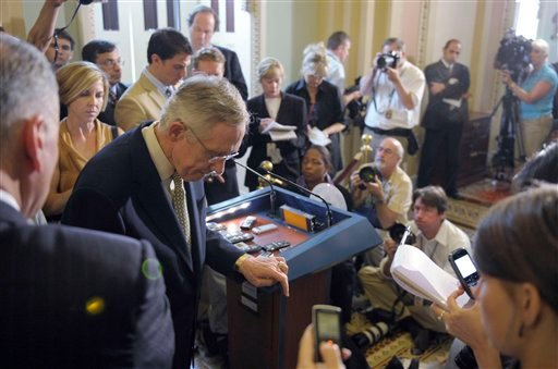 Senate Majority Leader Harry Reid of Nev., steps away from the microphone after speaking to reporters during a news conference on Capitol Hill in Washington, Friday, July 29, 2011.