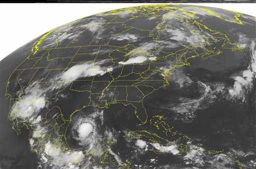 This NOAA satellite image taken Friday, July 29, 2011 at 1:45 a.m. EDT shows Tropical Storm Don continues moving through the western Gulf of Mexico, edging towards southeastern Texas.