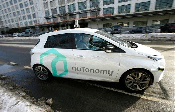 An autonomous vehicle is driven by an engineer on a street in an industrial park in Boston.