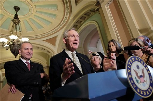 Senate Majority Leader Harry Reid of Nev., center, accompanied by Sen. Charles Schumer, D-N.Y., left, and Sen. Patty Murray, D-Wash., tells reporters that he is moving ahead with a Democratic plan to trim the deficit and avert a debilitating default. (AP)