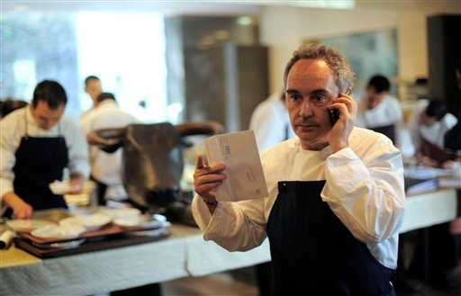 Spanish chef Ferran Adria as he speaks on the phone in his restaurant elBulli in Roses, Spain. El Bulli, one of the world's most acclaimed and award-winning eateries, is preparing to serve its last supper before closing. (AP)