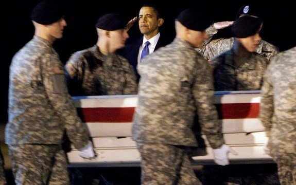 President Barack Obama, center, salutes as an Army carry team carries the transfer case containing the remains of Sgt. Dale R. Griffin of Terre Haute, Ind.