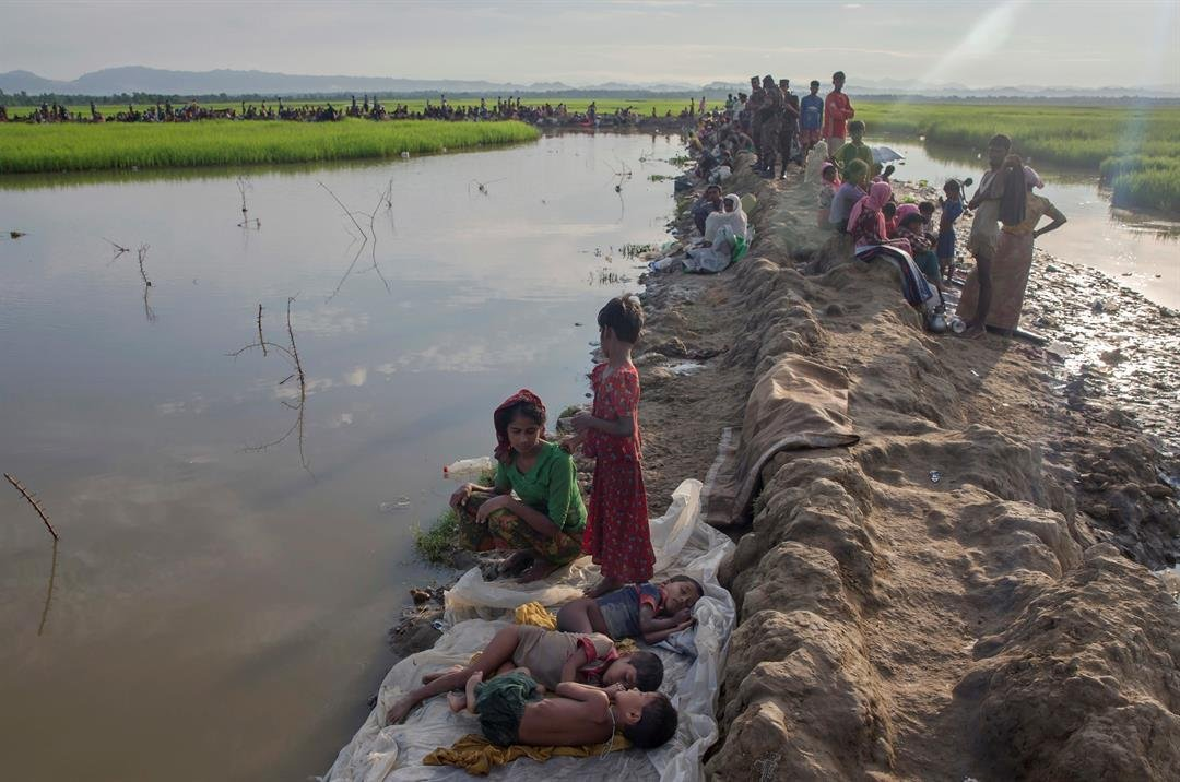 Thousands more Rohingya Muslims are fleeing large-scale violence and persecution in Myanmar and crossing into Bangladesh, where more than half a million others are already living in squalid and overcrowded camps, according to witnesses and a drone video s