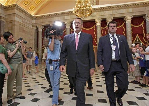House Speaker John Boehner of Ohio, walks on Capitol Hill in Washington, Monday, Aug. 1, 2011.