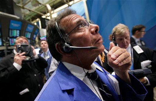 Trader Sal Saurino, center, works on the floor of the New York Stock Exchange Monday, Aug. 1, 2011. (AP Photo/Richard Drew)