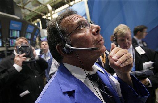 Trader Sal Saurino, center, works on the floor of the New York Stock Exchange Monday, Aug. 1, 2011. (AP Photo/Richard Drew)
