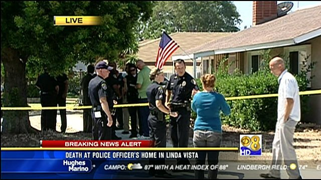 News 8 video screen shot of police presence outside Officer David Christopher Hall's Kearny Mesa home in the 3300 block of Ashford Street on Monday, August 1, 2011.