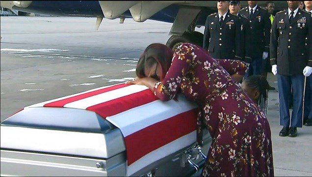 Myeshia Johnson cries over the casket of her husband, Sgt. La David Johnson, who was killed in an ambush in Niger.