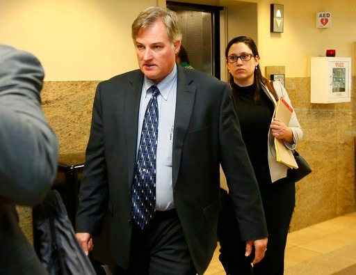 FILE - in this Friday, June 30, 2017, file photo, Shannon Kepler, left, arrives with his legal team for afternoon testimony in his third trial in Tulsa, Okla. (AP Photo/Sue Ogrocki, File)