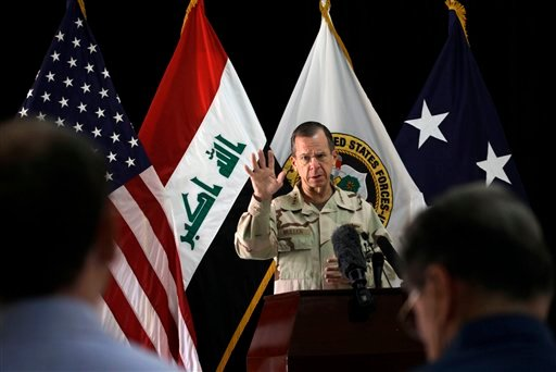 Chairman of the Joint Chiefs of Staff Adm. Mike Mullen speaks to reporters at a news conference in Baghdad, Iraq, Tuesday, Aug. 2, 2011.