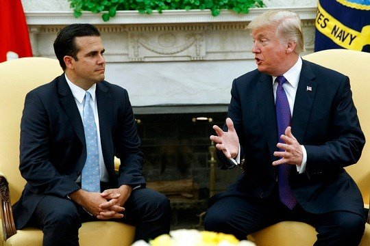President Donald Trump meets with Governor Ricardo Rossello of Puerto Rico in the Oval Office of the White House.
