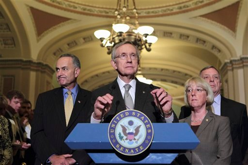 Senate Majority Leader Harry Reid of Nev. accompanied by fellow Senate Democratic leaders, speaks on Capitol Hill Aug. 2, 2011, after passage of the emergency legislation to prevent a default on government debt obligations. (AP Photo/J. Scott Applewhite)
