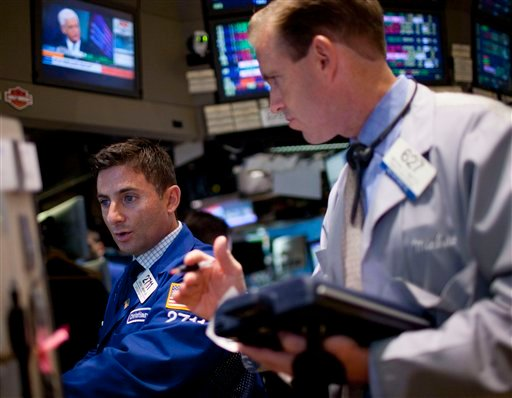 Traders work on the floor of the New York Stock Exchange on Wednesday, Aug. 3, 2011, in New York. (AP Photo/Jin Lee)