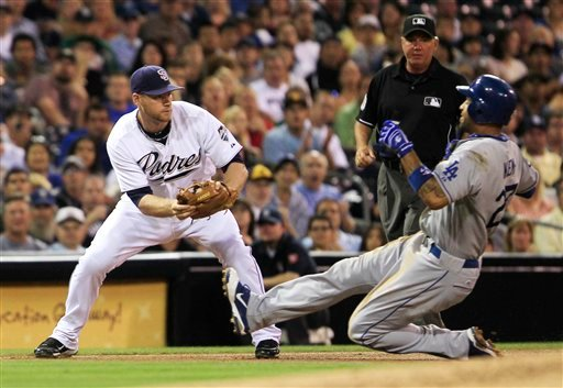 Los Angeles Dodgers' Matt Kemp slides into third on an attempted steal as San Diego Padres third baseman Chase Headley waits to put the tag on, in the fourth inning of a baseball game Tuesday, Aug. 2, 2011 in San Diego. The failed attempt ended Kemp's str
