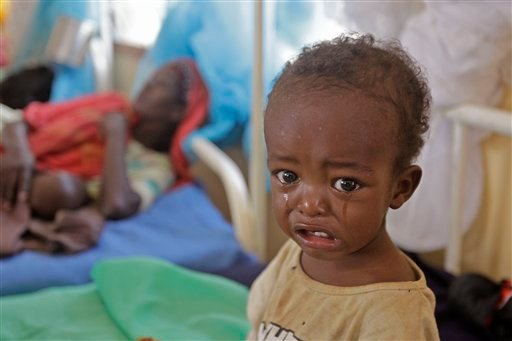 A malnourished child cries at a field hospital of the International Rescue Committee, IRC, in Dadaab, Kenya, Wednesday, Aug. 3, 2011. (AP Photo/Schalk van Zuydam)