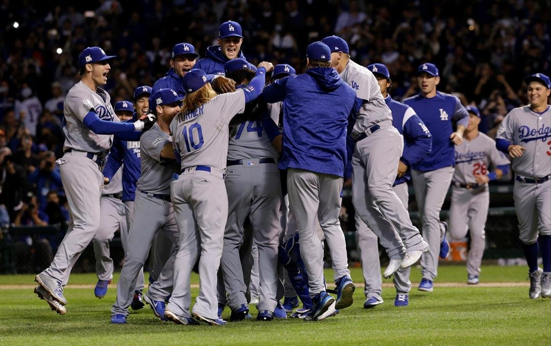 The Los Angeles Dodgers players celebrate after Game 5 of baseball's National League Championship Series against the Chicago Cubs, Thursday, Oct. 19, 2017, in Chicago. The Dodgers won 11-1 to win the series and advance to the World Series. (AP Photo/Nam Y