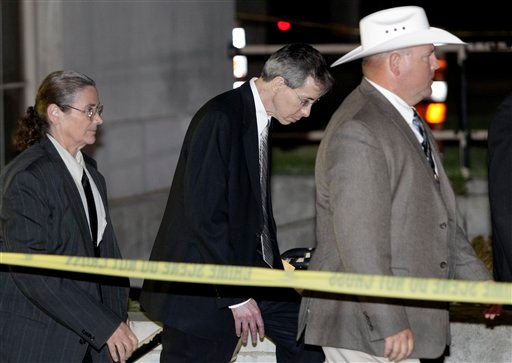 Polygamist religious leader Warren Jeffs, center, is escorted out of the Tom Green County Courthouse Tuesday, Aug. 2, 2011, in San Angelo, Texas.