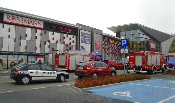 Police and firefighters' cars and trucks stand in front of the VIVO! shopping mall.