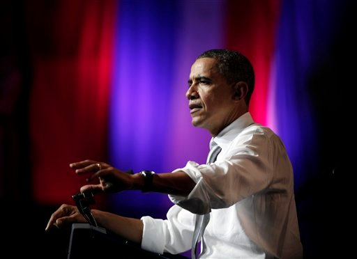 President Barack Obama pauses as he speaks at the Aragon Ballroom, Wednesday, Aug. 3, 2011, in Chicago, in Chicago, at a fundraiser on the eve of his 50th birthday. (AP Photo/Carolyn Kaster)