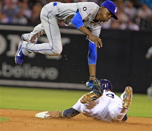Dodgers shortstop Dee Gordon sails through the air while attempting to catch a wild throw on a stolen base attempt by Padres' Luis Martinez in the seventh inning of a baseball game Aug. 3, 2011 in San Diego. (AP Photo/Lenny Ignelzi)