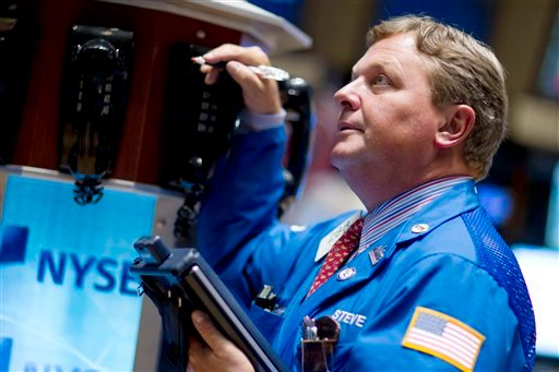 A trader works on the floor of the New York Stock Exchange on Thursday, Aug. 4, 2011 in New York. (AP Photo/Jin Lee)