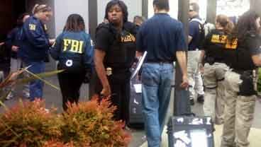 Photograph from the scene of the FBI raid at NexBio on Thursday, August 4, 2011. NexBio is a pharmaceutical company in Sorrento Valley.