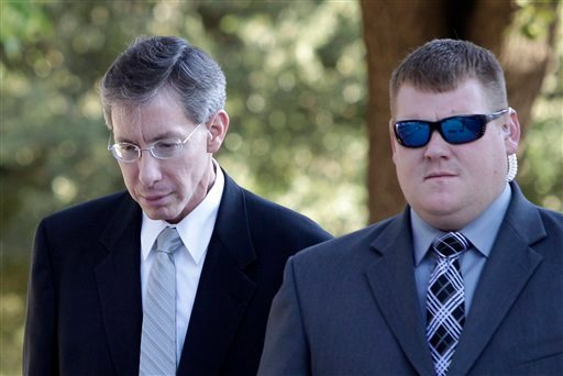 Polygamist religious leader Warren Jeffs, arrives at the Tom Green County Courthouse escorted by a law enforcement officer Wednesday, Aug. 3, 2011, in San Angelo, Texas. (AP Photo/Tony Gutierrez)