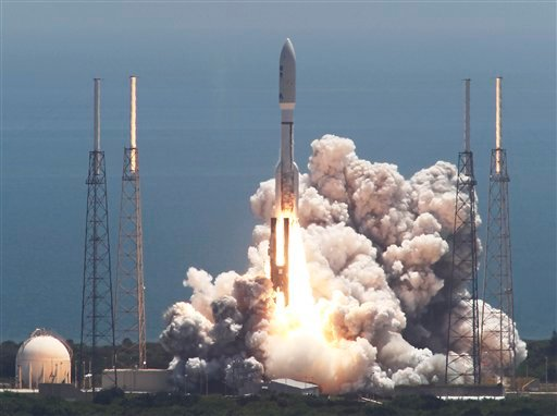 An Atlas V rocket with the Juno spacecraft lifts off from Space Launch Complex-41 in Cape Canaveral, Fla. on Friday, Aug. 5, 2011.