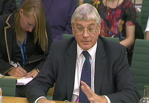 Metropolitan Police Director of Public Affairs and Internal Communication Dick Fedorcio gives evidence to the Home Affairs Select Committee on the News of the World phone-hacking scandal in this image taken from TV in the House of Commons (AP).
