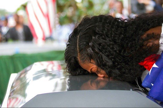 Myeshia Johnson kisses the casket of her husband, Sgt. La David Johnson during his burial service.