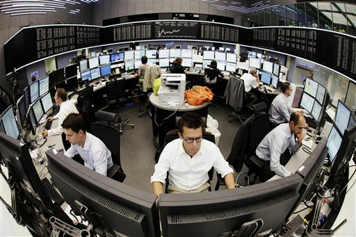 Stock traders work at the German stock exchange in Frankfurt, central Germany, Friday, Aug. 5, 2011. (AP)